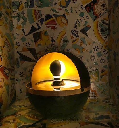 """Arluna, is a lamp that hide the light by a """"lid"""" that you can move just approaching a hand on the side of the lamp."""